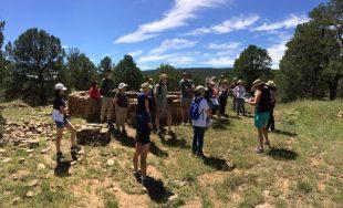 IArrowhead Pueblo hike - Park Ranger Susan discusses the D-shaped kiva at the pueblo site